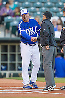 Oklahoma City Dodgers manager Damon Berryhill (55) shakes hands with first base umpire Travis Eggert prior to the game against the Nashville Sounds at Chickasaw Bricktown Ballpark on April 15, 2015 in Oklahoma City, Oklahoma. Oklahoma City won 6-5. (William Purnell/Four Seam Images)
