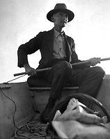 Elderly man with fishing pole in a boat, circa 1930's.   (photo: www.bcpix.com)