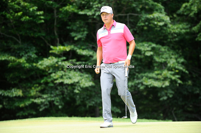 June 22, 2014 - Cromwell, Connecticut - Freddie Jacobson walks on the 11th green during the final round of the PGA Travelers Championship tournament held at TPC River Highlands in Cromwell, Connecticut.  Eric Canha/CSM