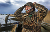 Brian LaFay puts on his bird calls as he prepares to leave the blind and take a boat out to check on other hunters he has set up in the Layout boat. He and a partner help duck hunters from around the country as they try hunting ducks along the Barnegat Bay in New Jersey.