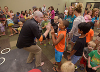 NWA Democrat-Gazette/BEN GOFF @NWABENGOFF<br /> Galen Harp of Institute of Jugglology from Fayetteville greets children on Thursday June 9, 2016 after a performance at the Bentonville Public Library. Harp and Winters won the International Jugglers Association team stage juggling world championship in 2014.