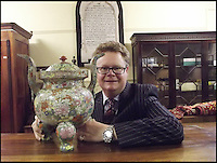 BNPS.co.uk (01202 558833)<br /> Pic: Charterhouse/BNPS<br /> <br /> ***Please use full byline***<br /> <br /> Delighted auctioneer Richard Brommel.<br /> <br /> How much does a chinese urn?....&pound;153,000 over its estimate.<br /> <br /> A broken Chinese urn that had been stored on top of a wardrobe and covered in dust for 20 years has sold at auction for &pound;155,000 - &pound;153,000 over its estimate.<br /> <br /> The owner, a man aged in his 50s, had inherited the urn from a relative decades ago and thought it was nothing more than a pot pourri holder.<br /> <br /> As the dust was wiped away a beautiful hand-painted design was revealed showing ornate flowers in pink, green, blue, and red.<br /> <br /> It was suspected that the piece dated back to the 1800s when China was under the rule of the Quianlong Emporer, and it was estimated to sell for &pound;2,000 at auction.<br /> <br /> The lot caused a frenzy of bidding with buyers from around the world placing bids over the phone, by internet, and in the sale room, and it finally sold for &pound;154,250.<br /> <br /> The unnamed owner, from Shaftesbury in Dorset, said that it was the 'best day of his life' after the ancient artefact sold for 75 times what he was expecting.<br /> <br /> It was sold by Charterhouse Auctioneers in Sherborne.