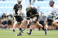 CHAPEL HILL, NC - MARCH 10: Emmet Kemble #18 of Bryant University picks up a loose ball during a game between Bryant and North Carolina at Dorrance Field on March 10, 2020 in Chapel Hill, North Carolina.