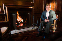 Yoshihide Hashimoto, Managing Director of Dojima Sake Brewery, sitting by a fire in Fordham Abbey House, Ely, UK, December 5, 2016.The Fordham Abbey Estate is set to be the site of the UK's first sake brewery. Work is underway on a new brewery and visitor centre, while the Grade II listed Georgian main house will host Japanese food and sake tasting events.