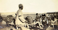 BNPS.co.uk (01202 558833)<br /> Pic: ClevedonAuctionRooms/BNPS<br /> <br /> Rev Griffith (white boater) prepares to set off by mule train.<br /> <br /> Rev Francis John Griffith travelled as a Missionary aroud Outer Mongolia in the 1920's.<br /> <br /> A fascinating collection of early 20th century photos of Mongolia and China which were taken by a British vicar doing missionary work have been unearthed after 97 years.<br /> <br /> Through his famine relief work Reverend Francis John Griffith was able to get a remarkable insight into the lives of the native population and their nomadic existence.<br /> <br /> His encounters were captured using a handheld camera that he carried with him at all times.<br /> <br /> In one image a family goes about its business outside the hut that is their home, while another image is of a man riding a camel which was the typical method of transport.<br /> <br /> Revd Griffith was able to get native elders to sit for him in portraits and there are intimate snaps of women and children wearing elaborate native headdresses.<br /> <br /> As well as the people, Revd Griffith took an interest in the surroundings and photographed temples and prominent buildings in addition to the vast, desert landscape.