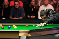 Ronnie O'Sullivan plays a long shot on a red ball during the Dafabet Masters FINAL between Barry Hawkins and Ronnie O'Sullivan at Alexandra Palace, London, England on 17 January 2016. Photo by Liam Smith / PRiME Media Images