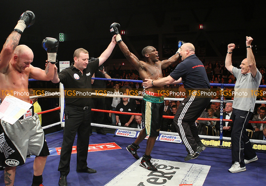 Ovill McKenzie (Canning Town, black shorts) defeats John 'Buster' Keeton (Sheffield, silver/grey shorts) to win the Final of Prizefighter 'The Cruiserweights' Boxing contest at Earls Court, London promoted by Barry Hearn / Matchroom Sports - 19/05/09 - MANDATORY CREDIT: Gavin Ellis/TGSPHOTO - Self billing applies where appropriate - 0845 094 6026 - contact@tgsphoto.co.uk - NO UNPAID USE.