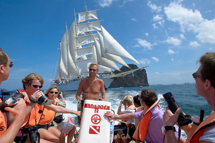 Aboard a fast Zodiac steered by Hotel Manager Peter, Star Flyer passengers get a photo opportunity to take pictures of the ship under full sails.