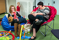 Two mothers brestfeeding at a drop-in breastfeeding support centre.