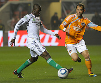 Chicago midfielder Patrick Nyarko (14) shields the ball from Houston midfielder Brad Davis (11).  The Chicago Fire defeated the Houston Dynamo 2-0 at Toyota Park in Bridgeview, IL on April 24, 2010.