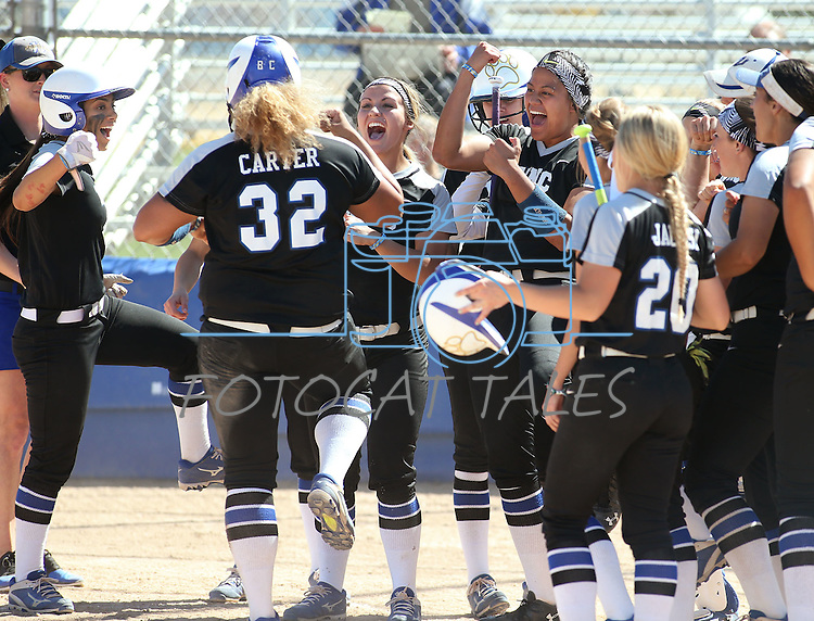 Western Nevada's Briauna Carter celebrates with teammates after hitting a 3-run homer against College of Southern Nevada at Edmonds Sports Complex in Carson City, Nev., on Friday, April 1, 2016. <br />