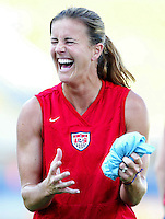 August 11th, 2004: Brandi Chastain, USA, shares some laughs with other players during a warm up before the first game against Greece at Pankritio Stadium in Heraklio, Greece..   USA defeated Greece, 3-1..Credit: Michael Pimentel / ISI