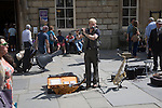 Male busker performing in Abbey churchyard, Bath, Somerset, England
