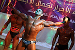 Palestinian men take part during competing in a bodybuilding contest at a hall in Gaza city, Nov. 3, 2011. Many of the men use women's cosmetics, mud, or paint to enhance their muscles. Number of men from around the Gaza Strip competed in the territory's bodybuilding championship. Participants say the Israeli blockade makes it harder for them to pump up and prevents them from participating in championships outside of the impoverished territory. Photo by Majdi Fathi