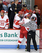 Andrew Glass (BU - 14) helps Bob Bernard with Justin Courtnall (BU - 19). - The Boston University Terriers defeated the visiting University of Toronto Varsity Blues 9-3 on Saturday, October 2, 2010, at Agganis Arena in Boston, MA.