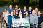Charity<br /> ---------<br /> Noel O'Connor, front Rt, along with many others organised a vintage run last June and donated the proceeds to Breda Dyland and Trish Kelly, front Left, of the Kerry Cancer Support Group last Saturday evening at the Half Way bar, Ballymac,