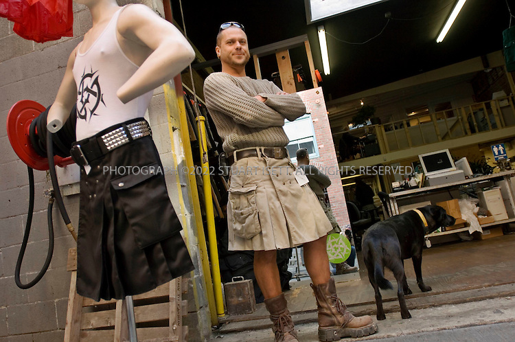 10/9/2006--Seattle, WA, USA..'Utilikilts' for Sale in Seattle. Steven Villegas (shown here)  owner of this unique Seattle clothier that has pioneered a comfortable alternative to trousers in the form of pocketed knee-length skirts for men. Utilikilts, located in an alley warehouse near Pioneer Square, peddles eight varieties of the garments including cotton, leather, duck cloth and lightweight nylon....Photograph By Stuart Isett.All photographs ©2006 Stuart Isett.All rights reserved.