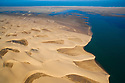 Namibia, Namib Desert, Skeleton Coast, aerial view of Sandwich Harbour; a natural bay at the edge of the Namib Desert