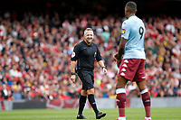 Referee, Jonathan Moss smiles during the Premier League match between Arsenal and Aston Villa at the Emirates Stadium, London, England on 22 September 2019. Photo by Carlton Myrie / PRiME Media Images.