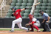 Hunter Jones (9) of the Kannapolis Intimidators follows through on his swing against the Lakewood BlueClaws at CMC-Northeast Stadium on May 17, 2015 in Kannapolis, North Carolina.  The Intimidators defeated the BlueClaws 4-1.  (Brian Westerholt/Four Seam Images)