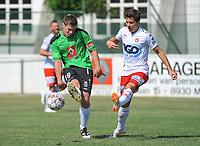 Oefenmatch KSK GELUWE - KV KORTRIJK :<br /> Martijn Minne (L) ontzet de bal voor de ogen van Tyron Ivanof (R)<br /> <br /> Foto VDB / Bart Vandenbroucke