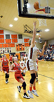 Westside Eagle Observer/MIKE ECKELS<br /> <br /> Mallory Smith (Lions 1) puts the ball off of the backboard and into the basket for a field goal durning the fourth quarter of the Gravette-Pea Ridge conference game in Gravette Friday night.