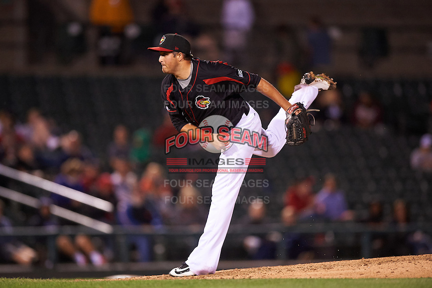 Rochester Red Wings relief pitcher D.J. Baxendale (22) follows through on a pitch during a game against the Syracuse Chiefs on July 1, 2016 at Frontier Field in Rochester, New York.  Rochester defeated Syracuse 5-3.  (Mike Janes/Four Seam Images)