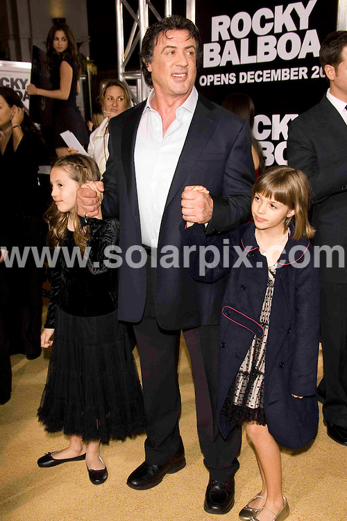 ALL ROUND PICTURES FROM SOLARPIX.COM SYNDICATION RIGHTS FOR UK, SOUTH AFRICA, DUBAI, AUSTRALIA..Sly Stallone and family arrive at the premiere of the film, ROCKY BALBOA in Hollywood, Ca. at Grauman's Chinese Theater on Dec 13, 2006...DATE: 13/12/2006-JOB REF: 3164-PHZ.**MUST CREDIT SOLARPIX.COM OR DOUBLE FEE WILL BE CHARGED**