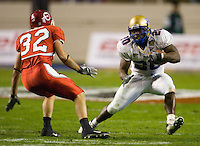 23 December 2006: Tulsa running back Courtney Tennial (#20) dodges Utah defender Chris Chamberlain (#32) during the 2006 Bell Helicopters Armed Forces Bowl between The University of Tulsa and The University of Utah at Amon G. Carter Stadium in Fort Worth, TX.