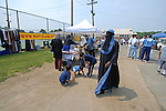 Vendors gathered outside selling books, DVDs, and women's Islamic fashions at the Islamic Games in South Brunswick, New Jersey on May 26, 2007.