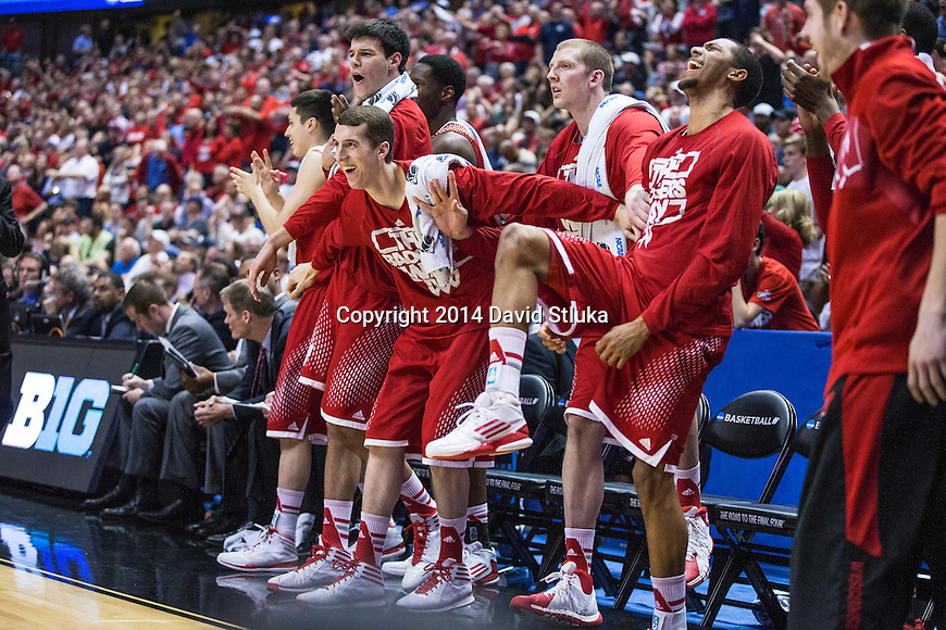 Wisconsin Badgers teammates celebrate during the Western Regional Final NCAA college basketball tournament game against the Arizona Wildcats Saturday, March 29, 2014 in Anaheim, California. The Badgers won 64-63 (OT). (Photo by David Stluka)