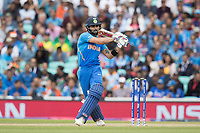 Virat Kolli (India) pulls a short delivery from Nathan Coulter-Nile (Australia) through mid wicket for four during India vs Australia, ICC World Cup Cricket at The Oval on 9th June 2019