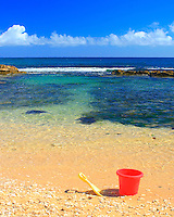 Pail and shovel at Mama's Fish House beach, north shore, Maui, Hawaii.