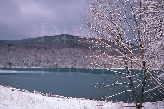 A mountain lake partly frozen over in the Pennsylvania high country.