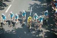 Team Astana rolls out of Evry for the last stage of the 101th Tour.<br /> As winners of the yellow jersey they pose for the traditional 'riding champagne shot' for the photographers.<br /> <br /> 2014 Tour de France<br /> stage 20: ITT Bergerac - P&eacute;rigueux (54km)