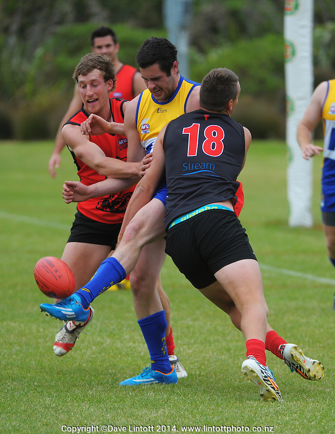 Action from the Wellington Australian Rules Football National Provincial Championship final match between the Canterbury Cobras (black and red) and Otago Riot (blue and gold) at Hutt Park, Wellington, New Zealand on Saturday, 6 December 2014. Photo: Dave Lintott / lintottphoto.co.nz