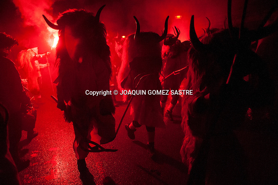During the carnival of Alsasua young Momotxorros dressed in skins and horns roam the streets of the village