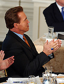 Washington, DC - February 23, 2004 -- California Governor Arnold Schwarzenegger applauds the remarks of United States President George W. Bush during a meeting of the National Governors Association in the State Dining Room at the White House in Washington, D.C. on February 23, 2004..Credit: Ron Sachs / CNP