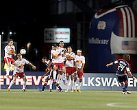 New York Red Bulls midfielder Dax McCarty (11) heads the direct kick by New England Revolution midfielder Lee Nguyen (24). New England Revolution forward Jerry Bengtson (27), New York Red Bulls defender Connor Lade (16), New York Red Bulls forward Tim Cahill (17), New York Red Bulls defender Jan Gunnar Solli (8), and New York Red Bulls midfielder Teemu Tainio (6) made up the remainder of the wall. Despite a red-card man advantage, in a Major League Soccer (MLS) match, the New England Revolution tied New York Red Bulls, 1-1, at Gillette Stadium on September 22, 2012.