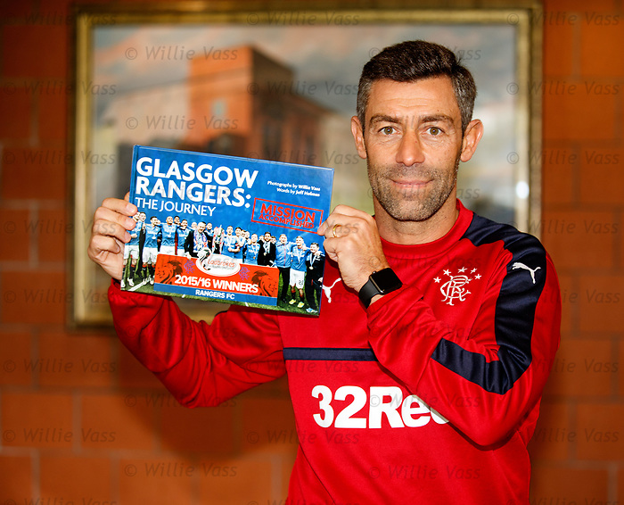 Rangers manager Pedro Caixinha with the Rangers Journey book <br />