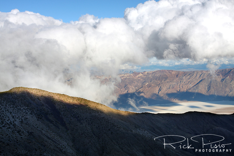 Clouds form over Death Valley and the Badwater Basin in Death Valley National Park.