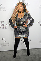 www.acepixs.com<br /> September 14, 2017  New York City<br /> <br /> Lil Kim attending Rihanna's 3rd Annual Clara Lionel Foundation Diamond Ball on September 14, 2017 in New York City.<br /> <br /> Credit: Kristin Callahan/ACE Pictures<br /> <br /> <br /> Tel: 646 769 0430<br /> Email: info@acepixs.com