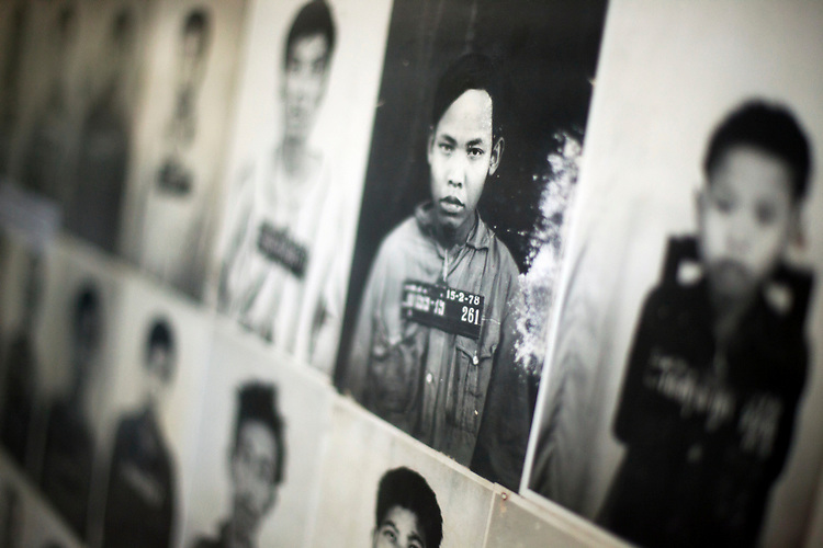 Photo display of victims of the Khmer Rouge at the Toul Sleng Genocide Museum in Phnom Penh, Cambodia. <br /> <br /> Photos &copy; Dennis Drenner 2013.