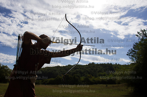 Mihai Cozmei of Romania is silhouetted during the European Open Championship of Horseback Archery in Veroce, about 60 km (37 miles) north of the capital Budapest, Hungary on August 31, 2012. ATTILA VOLGYI