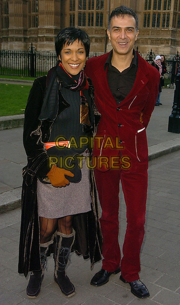 KIM VITHANA & IAN ASPINALL.Woman's Own Children of Courage Awards Departures, London..UK, United Kingdom.14th December 2005.Ref: CAN.full length with together red velvet suit brown long winter coat knee high flat boots lace-up.www.capitalpictures.com.sales@capitalpictures.com.©Capital Pictures