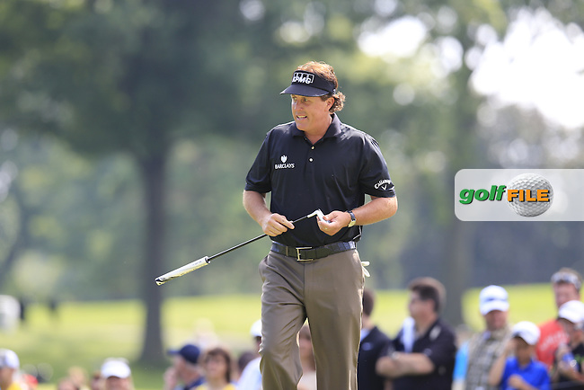 Phil Mickelson (USA) putts on the 14th green during Friday's Round 1 of the 2013 Bridgestone Invitational WGC tournament held at the Firestone Country Club, Akron, Ohio. 2nd August 2013.<br /> Picture: Eoin Clarke www.golffile.ie