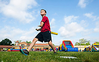 NWA Democrat-Gazette/JASON IVESTER<br /> Ayson (cq) Tackett (cq), fifth-grader, takes a swing on a pitch in wiffle ball Thursday, May 18, 2017, during the Fun and Field Day at Old High Middle School in Bentonville. Next Friday is the last day of school for Bentonville students.