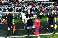 Referee Craig Pawson picks up the ball as he leads the tems onto the pitch during the Premier League match between Swansea City and Crystal Palace at The Liberty Stadium, Swansea, Wales, UK. Saturday 23 December 2017