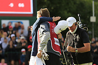 Matthew Fitzpatrick (ENG) hugs caddy Jamie after he wins the tournament after a 3 hole playoff at the  end of Sunday's Final Round of the 2017 Omega European Masters held at Golf Club Crans-Sur-Sierre, Crans Montana, Switzerland. 10th September 2017.<br /> Picture: Eoin Clarke | Golffile<br /> <br /> <br /> All photos usage must carry mandatory copyright credit (&copy; Golffile | Eoin Clarke)