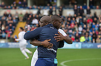Adebayo Akinfenwa of Wycombe Wanderers & John Akinde of Barnet during the Sky Bet League 2 match between Wycombe Wanderers and Barnet at Adams Park, High Wycombe, England on 22 October 2016. Photo by Andy Rowland.